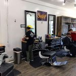 Barber, Sergio, is setting up his station for his next client at Santa Cruz